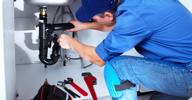 Plumber preforming repairs to plumbing