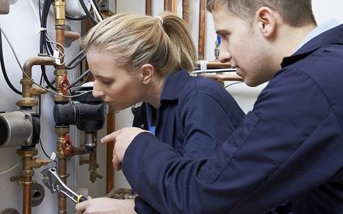 Plumbers installing complete plumbing solution